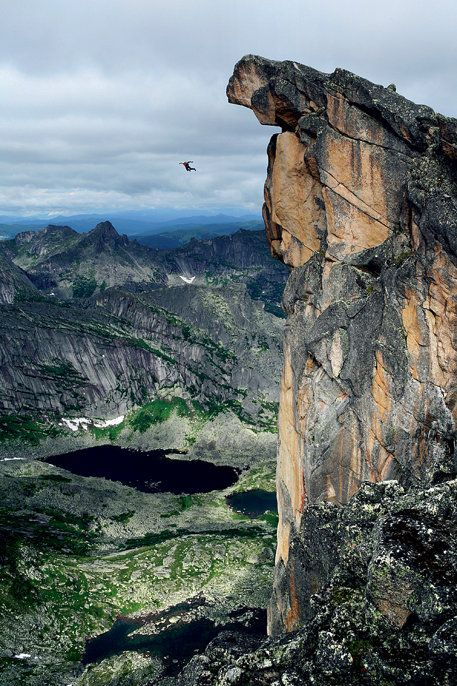 base jumping off a cliff with a parachute of course.