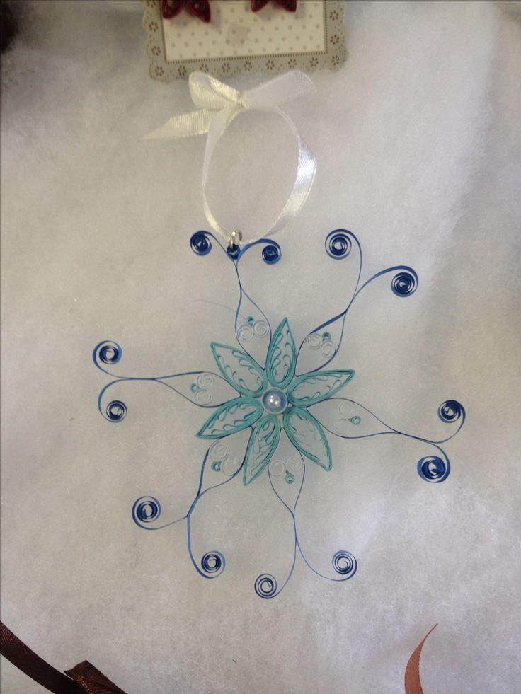 Paper quilled snowflake.