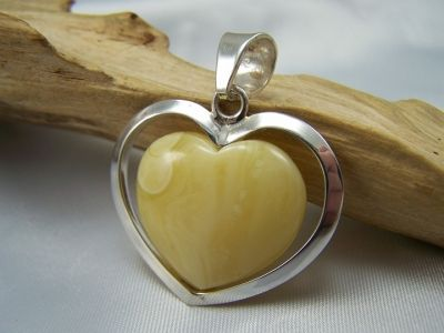 A lovely light colour milky amber heart pendant with a sterling silver frame 925.