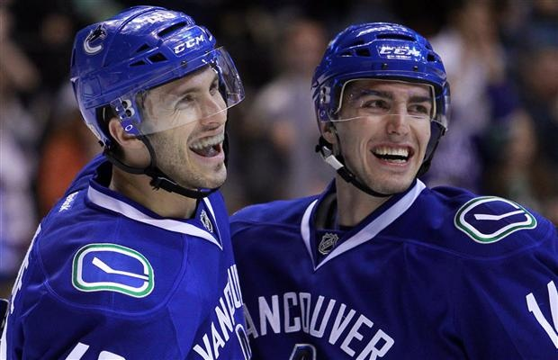 Maxim Lapierre (L) and Alex Burrows (R) Of the Vancouver Canucks