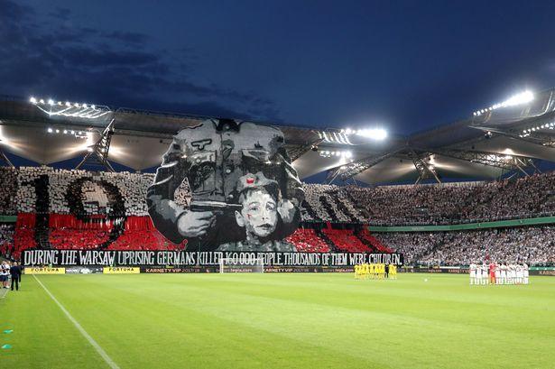 Legia Warsaw fans unveil striking anti Nazi tifo during Champions League match - Daily Record