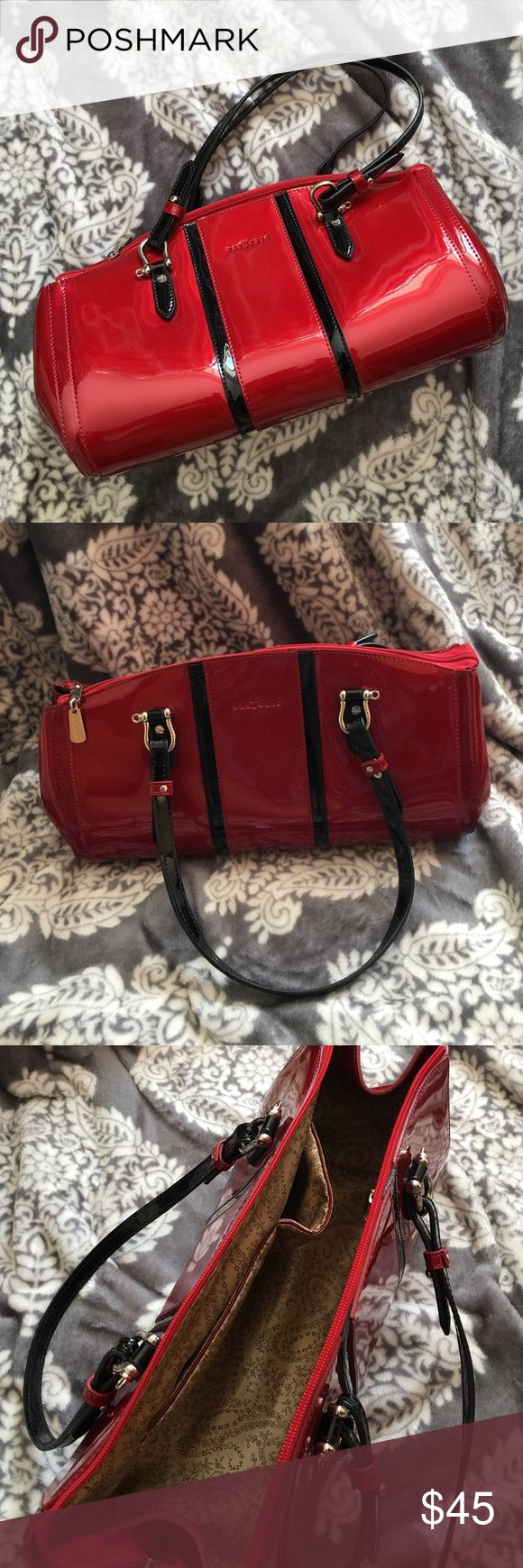Red Patent Leather Frederic T Handbag Direct from Paris! This unique red stunner is a hard find in the US. Beautiful red patent leather with black accents and silver hardware. Used less than five times! Comes with dust bag. From a pet free and nonsmoking home. Frederic T Bags Shoulder Bags