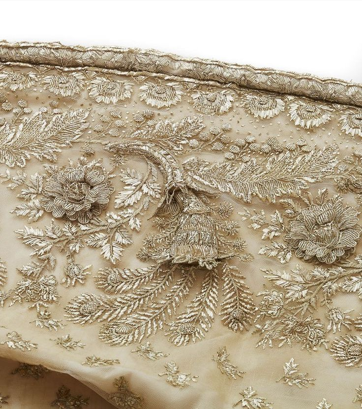 Court train, First Empire    From the Chateau de Malmaison Costume Collection app:        The use of platinum metallic thread to decorate this train is an indication of its exceptional status. This embroidery includes horns of plenty and flowers in full bloom in relief, demonstrating the exceptional skill of the embroiderers who supplied the imperial court with the official costumes Napoleon demanded....""