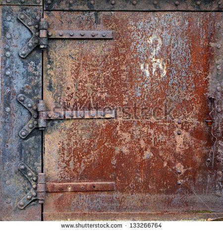 Rusty steel door and door hinges - stock photo