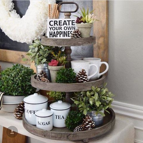 Wondering how to decorate a tiered tray, without breaking the bank? The generous proportions of our Wooden Three Tiered Tray make styling it a breeze! We added our enameled Coffee, Tea, Sugar Tins, some white mugs, straws for stirring, faux greenery, and pinecones for a simple, fun coffee/tea station. If you're in the market for a tired tray, head over to the shop and grab one while they're 15% off! Link in profile. #tieredtray #enamelware #coffeestation #teastation