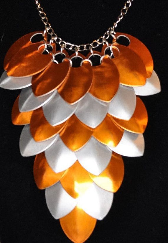 This stunning orange and silver scale maille necklace is sure to please anyone on your gift list. The perfect statement necklace to give to your best friend to show her your thinking of her or for that special someone because you care. Even to treat yourself because you deserve it. Perfect as bridal jewellery, party wear or prom wear.  • My scale maille pieces are made from good quality aluminium scales, linked with silver plated jump rings and hung on silver plated curb chain.  • Each scale…