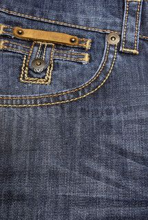 Forward pocket of jeans with the leather tablet