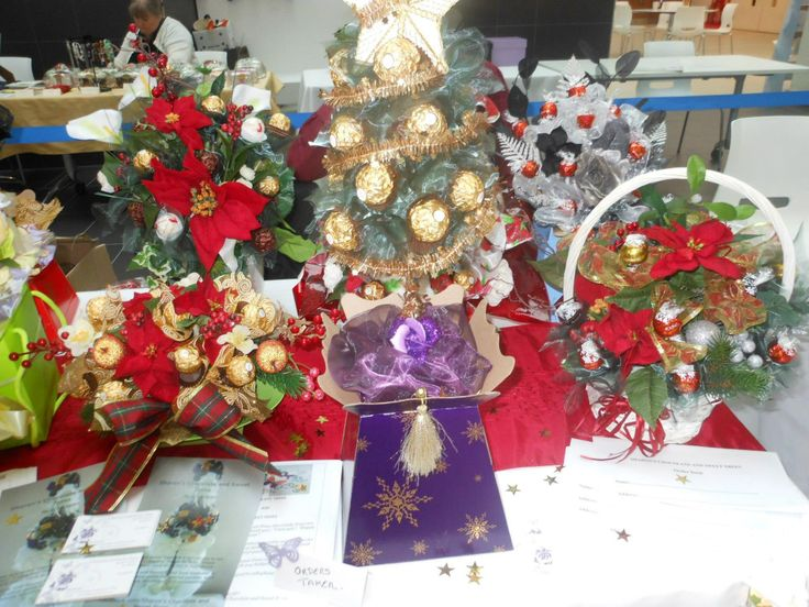 Christmas table centre pieces with silk flowers and chocolates