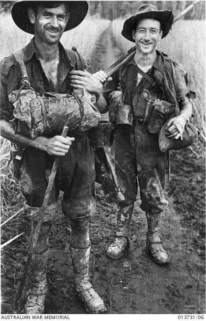 Two members of the 2/33rd Battalion coming out for a spell from their own position which was then just one hundred yards from the Japanese positions. Identified is NX44907 Sergeant Stanley Pretty, of Engadine, NSW (right).