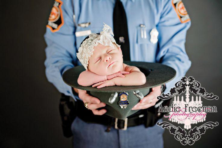 Newborn baby girl in daddy's state trooper police hat. www.TheAthensNewbornPhotographer.com
