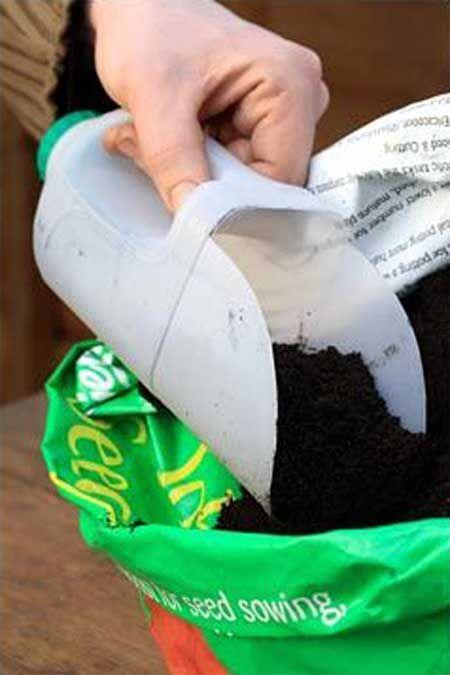 12. DIY garden scoop or mini greenhouse from a milk jug.