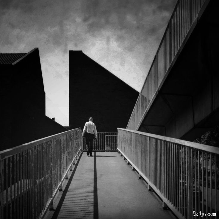 iPhoneography – { geometry } - The location with leading lines, shadows and strong geometric shapes is such a powerful composition that it is perfect for my fisherman style of street photography. As strong as the location is it needed a figure and ideally a single one. Having got into position it was just a case of waiting for the right character to walk through the scene.