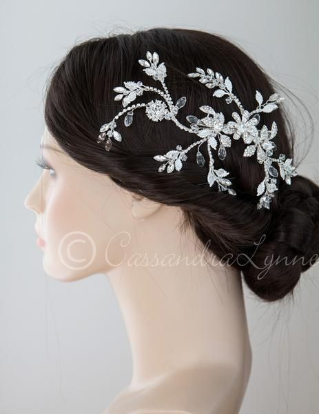 Each spray of this radiant bridal hair clip is tipped with marquise jewels, crystal beads and silver leaves. The center is  a single flower and rhinestone leave