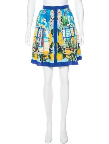 Red, blue and multicolor Dolce & Gabbana knee-length skirt with Carretto Siciliano print throughout and concealed zip closure at center back.