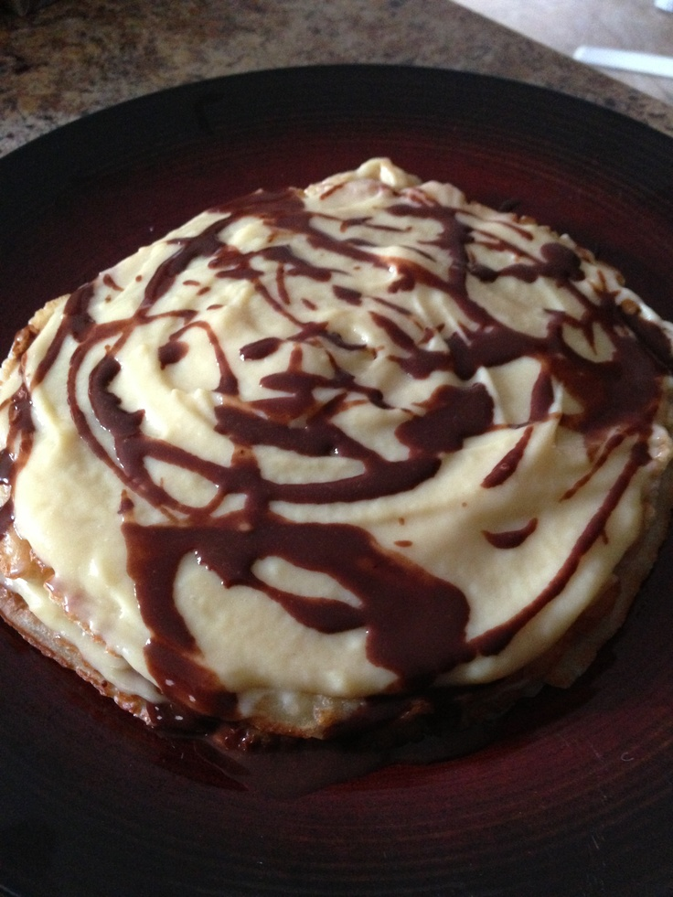 Boston cream pancake with chocolate syrup.