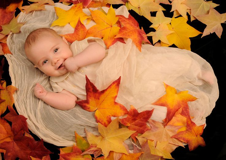 Baby in autumn leaves rjn photography