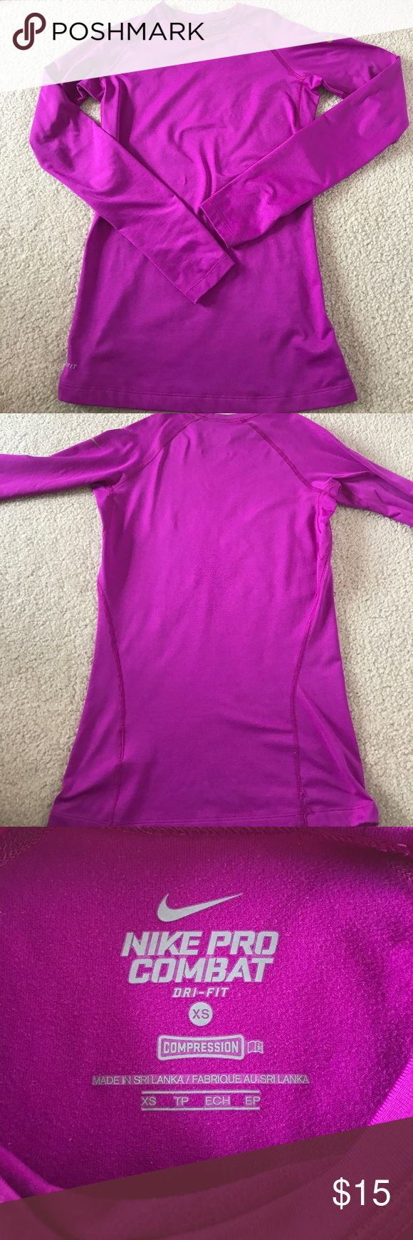 Nike Purple Long Sleeved Shirt This has been worn a few times and it's been tucked away in the back of my closet for many years now. It is a dri-fit Nike Pro Combat purple shirt, and is tight fitting to the body. It's made out of thicker material, perfect for the autumn or wintertime. It has thumb holes as shown in the 5th photo. However, there is slight damage to it as some areas have frayed a little (seen in the fifth photo) but it is not noticeable. Feel free to ask for a price reduction…