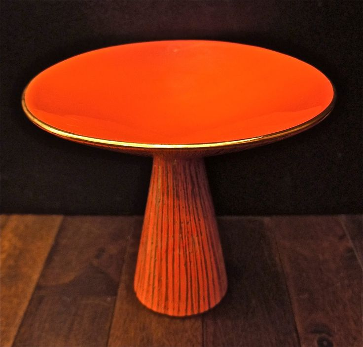 """Blood orange in color with gilded sgraffito...grand in scale at 9"""" tall and 10.5"""" wide. Bitossi, 1950s"""