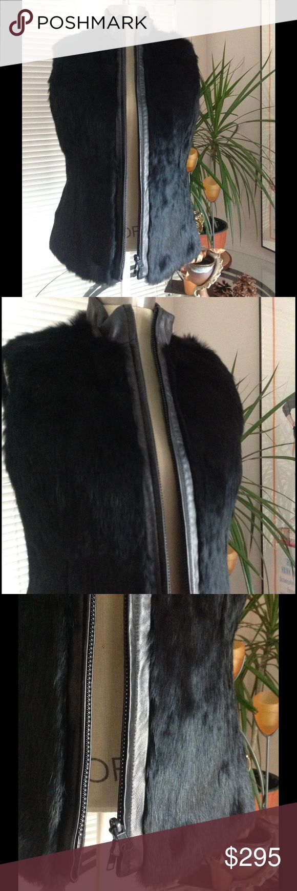 Cozy Warm Fur w/leather trim Vest New/w tag NWT Totally on Trend, Dana Buchman Fur and Leather Trim Vest. Fully lined with embossed pattern black fabric. Soft leather trim around the collar and all down the zipper. Zip front. Real fur. Just beautiful!  Imagine this vest over a beige turtleneck with black skinny jeans and booties, HOT! Suggested retail price @ $650.00  Style #DBMU7385 Offers Accepted.... Dana Buchman Jackets & Coats Vests