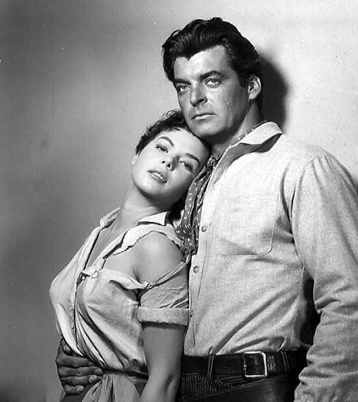 FOUR GUNS TO THE BORDER (1954) - Rory Calhoun & Colleen Miller - Directed by Richard Carlson - Universal-International Pictures - Publicity Still.
