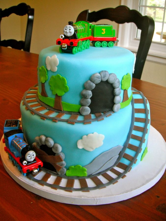 I made this for my 3 year old cousin who loves trains. all fondant decorations except trains. I bought the train toys online.