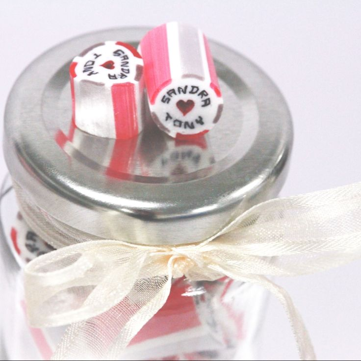 weddings designer candy personalised name candy lollipop event favors bomboniere love heart ribbon guest favors thank you just married inspiration planning giveaway table decor inspo fantasy fun witty unique different cute vintage rustic old fashioned traditional modern venue place cards flower girl bride to be groomsman dress