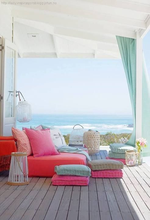 the couches with a lot of cushions look comfy Beach house..one day the beach will be my back yard :)
