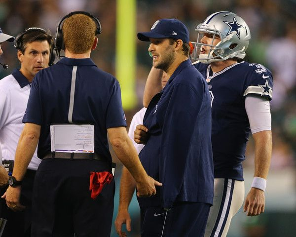 Tony Romo Photos Photos - Tony Romo #9 of the Dallas Cowboys talks with head coach Jason Garrett and quarterback  Brandon Weeden #3 in the fourth quarter against the Philadelphia Eagles on September 20, 2014 at Lincoln Financial Field in Philadelphia, Pennsylvania.The Dallas Cowboys defeated the Philadelphia Eagles 20-10. Romo was injured in the third quarter and did not return to the game. - Dallas Cowboys v Philadelphia Eagles