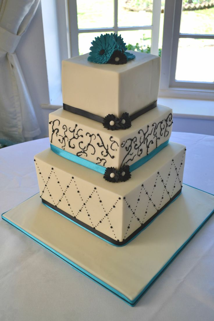 Turquoise and black three teir wedding cake.  www.facebook.com/TheWhitstableCakeCompany