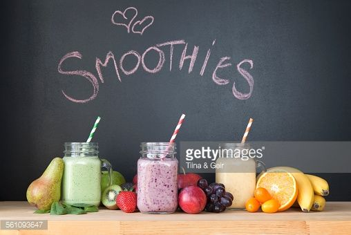Still Life Of Three Fresh Smoothies In Front Of Blackboard Stock Photo | Getty Images