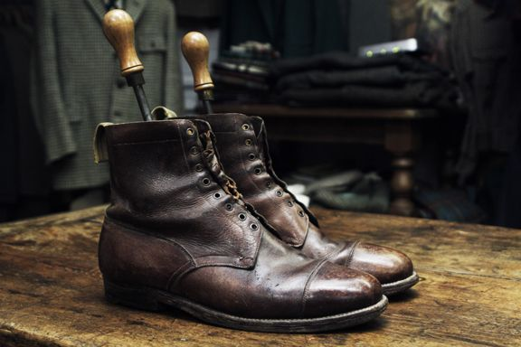 """These Second World War private purchase officers boots have the original Peal's """"S.P."""" shoe trees, gold foil blocked logo inside and hobnail soles, and have taken on the patina of polished prize-winning conkers."""