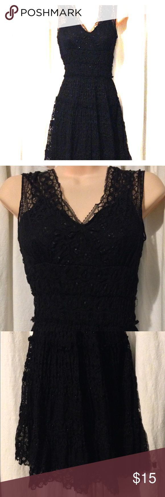 Beautiful cocktail dress! This amazing shimmering black lace layered cocktail dress is great for any occasion.. dinner, parties, school dances, formal occasion and it even has that swish that's made for dancing!!    It hangs right below my knees. I'm 5'3  It says it's a size Small but it fits a medium also..  Only worn once! And now I'm way to big to fit into it.... so it was time to Posh it up for sale!! :) Studio M Dresses Prom