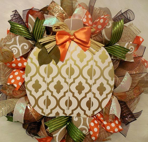 This 24 x 8 Fall Décor Wreath was crated with a natural jute Deco mesh, holds twists of chocolate, cream with gold stripes and apple green deco mesh. This wreath is covered in hints of orange and a shimmering green, along with a glitter white, white swirl, and sheer pumpkin with