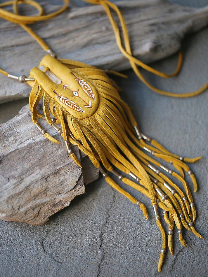 Earth Medicine Bag in gold deerskin with crystal quartz point  by Three Arrows Leather. Available on freepeople.com