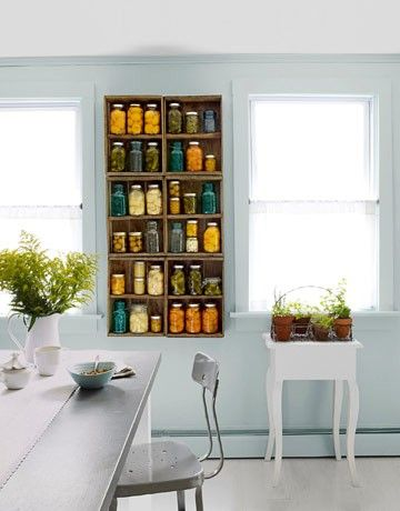 oh wow....canned goods + old blue canning jars shelved on old boxes used as shelves.  I'm SO doing this.