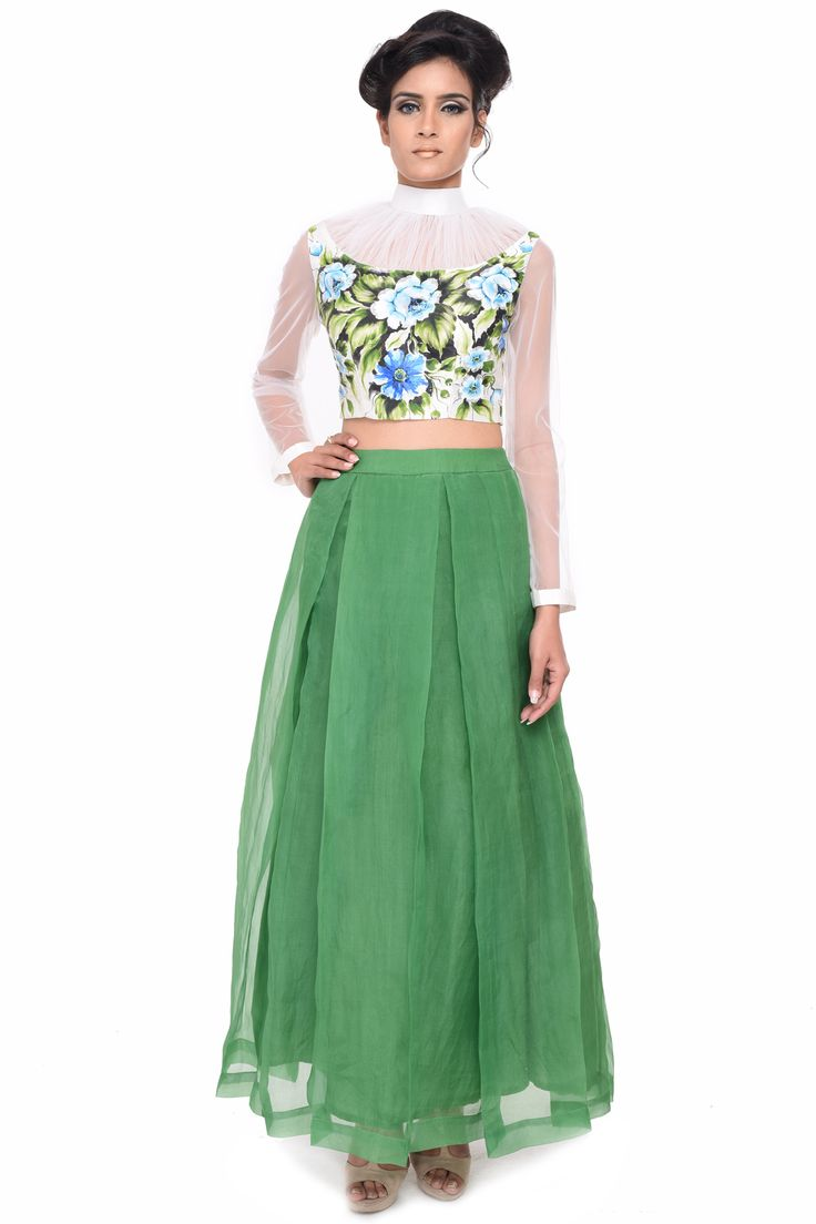 For trendy style statement, get your hands on this stunning ensemble. The crop top and skirt is designed with organza fabric and displays a stunning hand painted floral design. The full length green colored skirt perfectly complements the crop top. It has a zip for the closure.