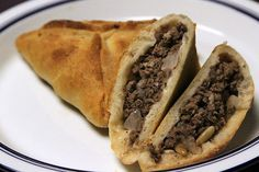 Authentic Nigerian Meat Pie recipe, with easy, step-by-step instructions and resources to obtain traditional, often hard to find ingredients.