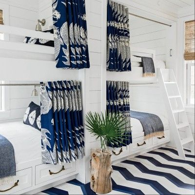 To ensure this space holds up to frequent use, the designer chose a durable outdoor fabric for the bunk curtains, while a bold, hand-painted floor keeps things playful | Coastalliving.com