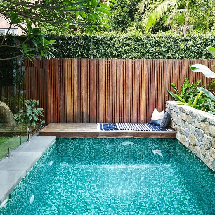 We designed a timber decking platform at one end of the pool to house the swim jet pump but it also doubles as the perfect place to chill.