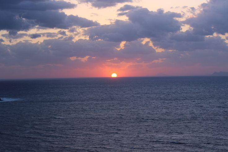 When the sun kisses the horizon. Santorini, Greece. #Travel #Love #Greece