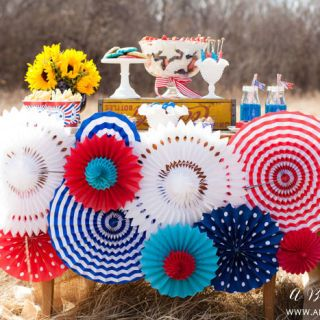 A Pop of Pattern Paper medallions jazz up a picnic table in this sweet outdoor party.