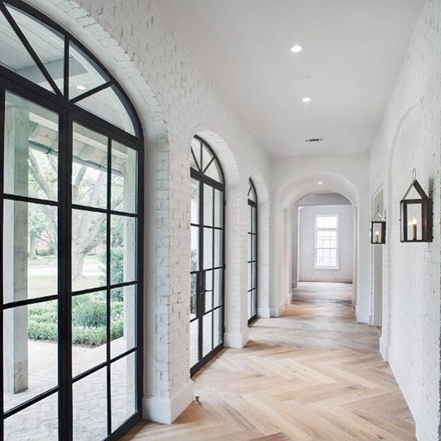 white brick on the interior...yes!! black windows, chevron floor, archways