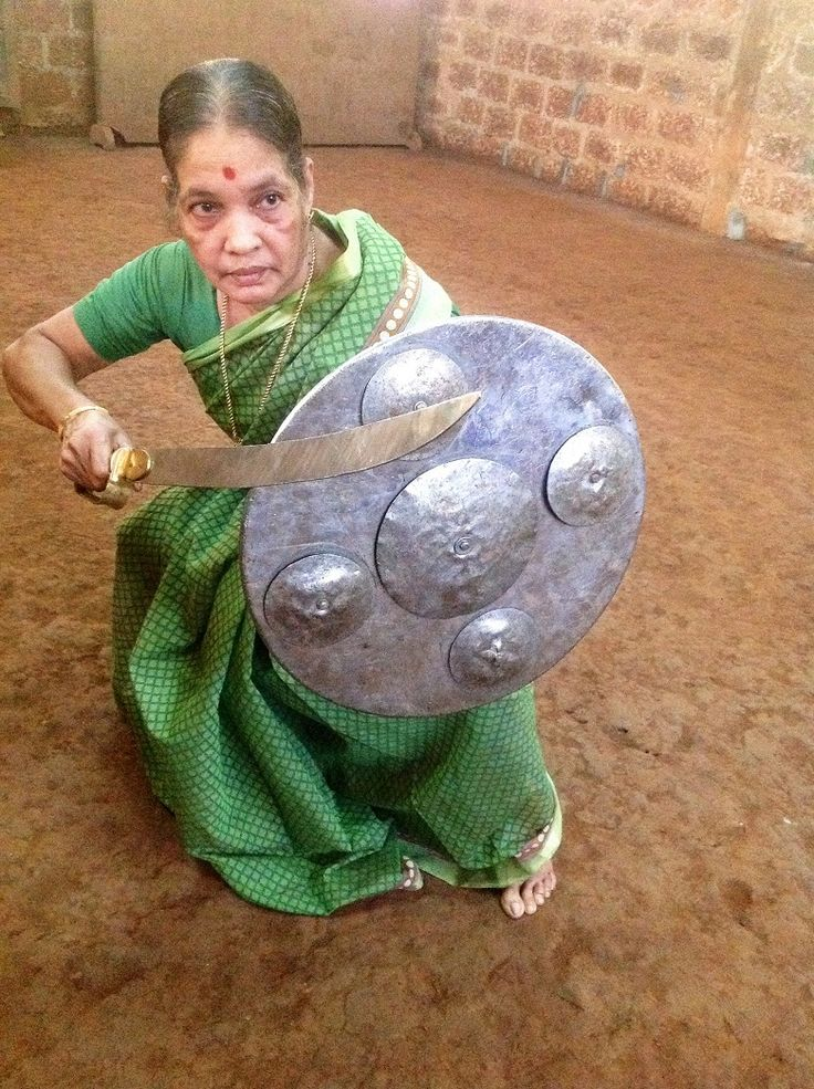 """ Defying age with a sword: Meenakshi Gurrukkal, Kerala's grand old Kalaripayattu dame ""Meenakshi Gurukkal crouched low, sword poised; her eyes..."