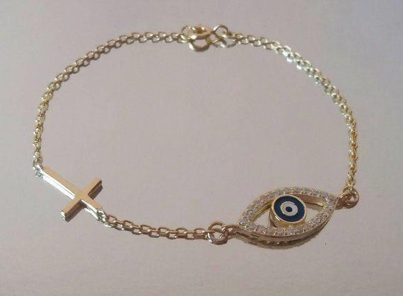 Evil+eye+bracelet+gold+sideways+cross+by+JewelryFamousWorld