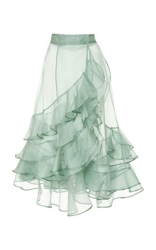 a sheer desgin rendered in silk organza with a high waist and voluminous hem.