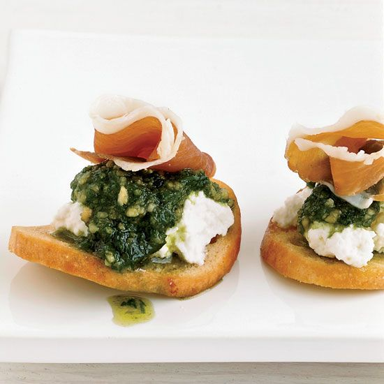 Bagel Chips with Ricotta, Chive Puree and Prosciutto | Using bagel chips as the base for an hors d'oeuvre is a quick way to add flavor and crunch. Grace Parisi tops the chips with fresh ricotta, chive puree and prosciutto. As an alternative, she sometimes uses dried apricot halves in place of the chips.