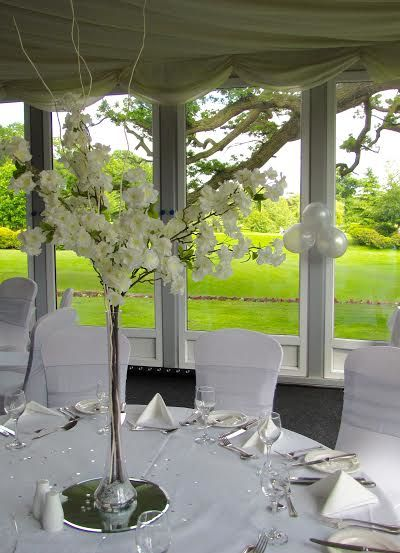 Tall blossom centrepiece with twisted willow