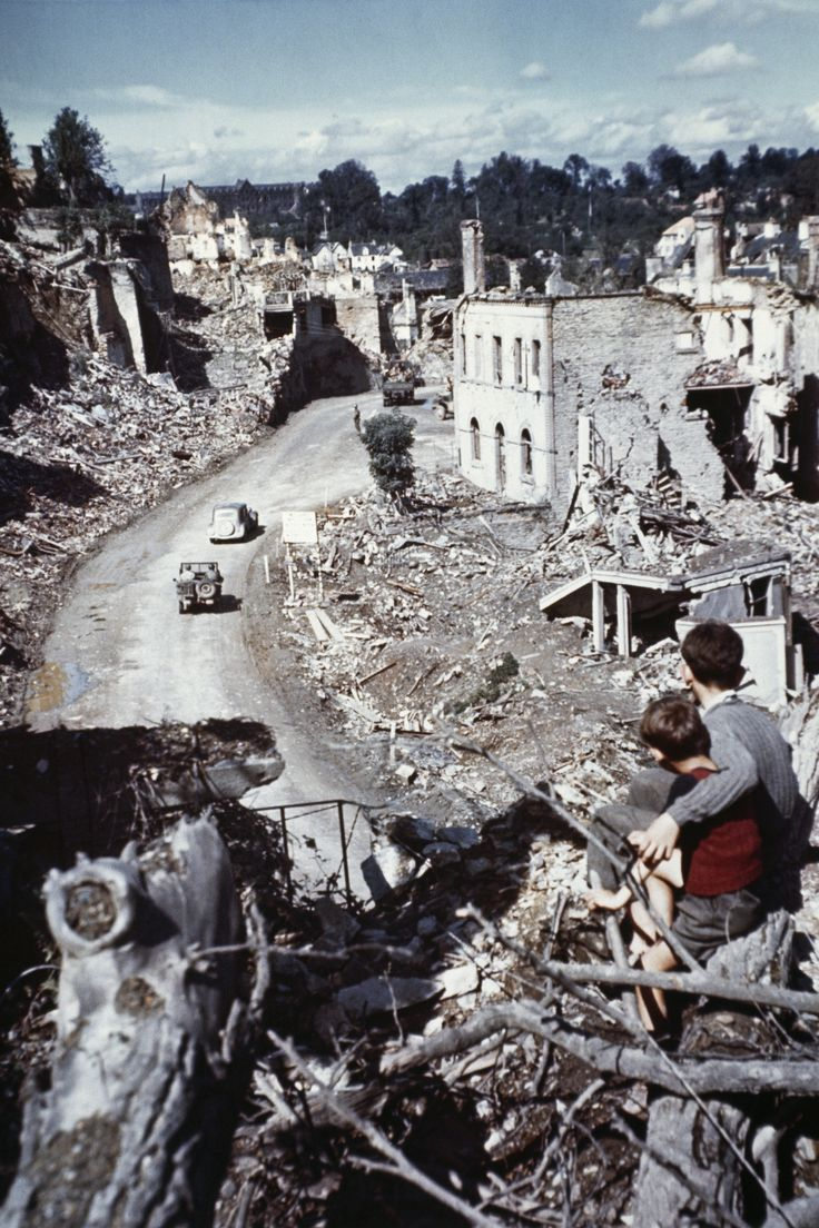 June 1944, two boys overlooking the ruined remains of the village of St. Lo, France after the D-Day invasion of Normandy.