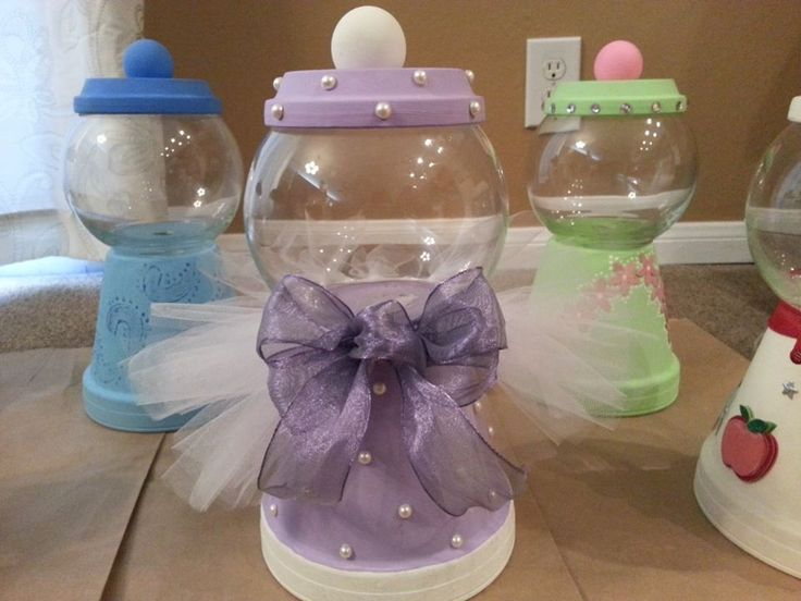 Gumball machine look a likes..I glued a small fish bowl on a clay pot turned upside down. Then decorated each one.