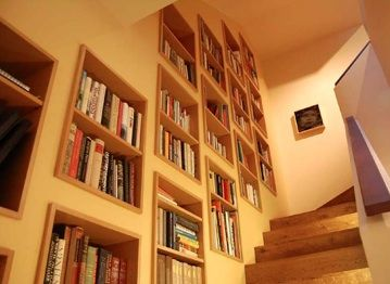 25 best ideas about wall bookshelves on pinterest for Diy staircase drawers